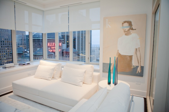 An all-white living room looking out at the Allenton Hotel