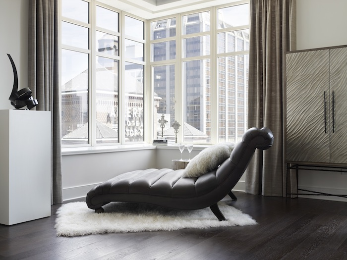 A reclining chair looking out at a window