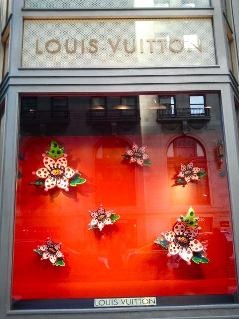 Louis Vuitton storefront exterior with Yayoi Kusama window displays