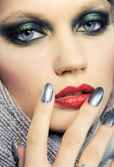 Fashion portrait of woman showing off her nails