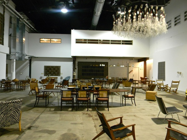 Inside the Wright auction house, filled with dining room tables and chairs