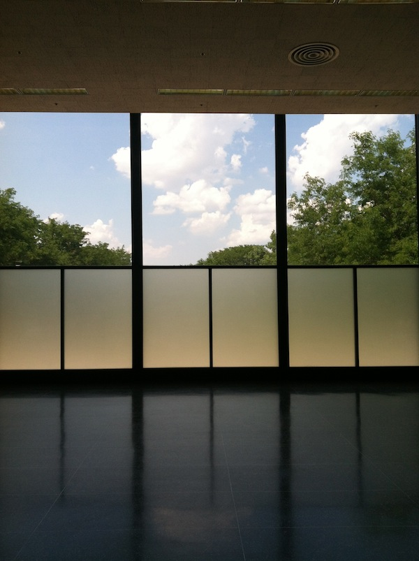 A serene empty room with Japanese-style windows