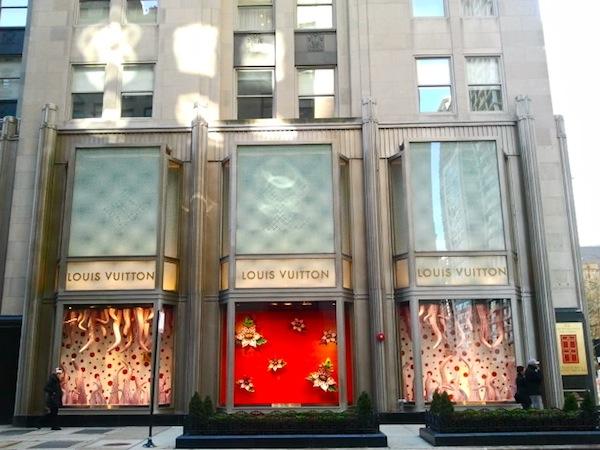 The Louis Vuitton Michigan Ave store windows with Yayoi Kusama window displays
