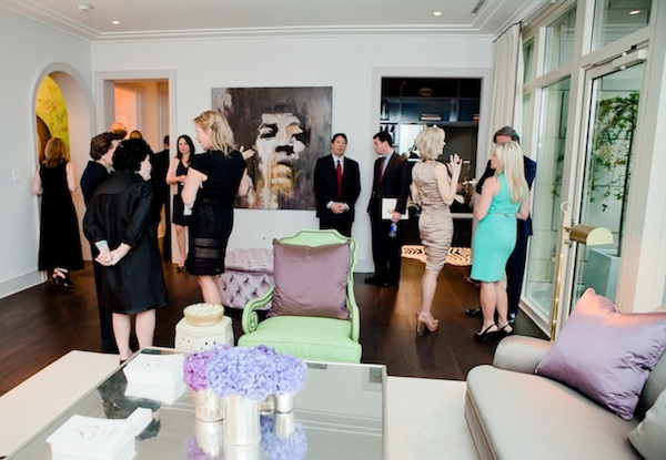 A group gathered in a living room at Samantha Todhunter's showcase home