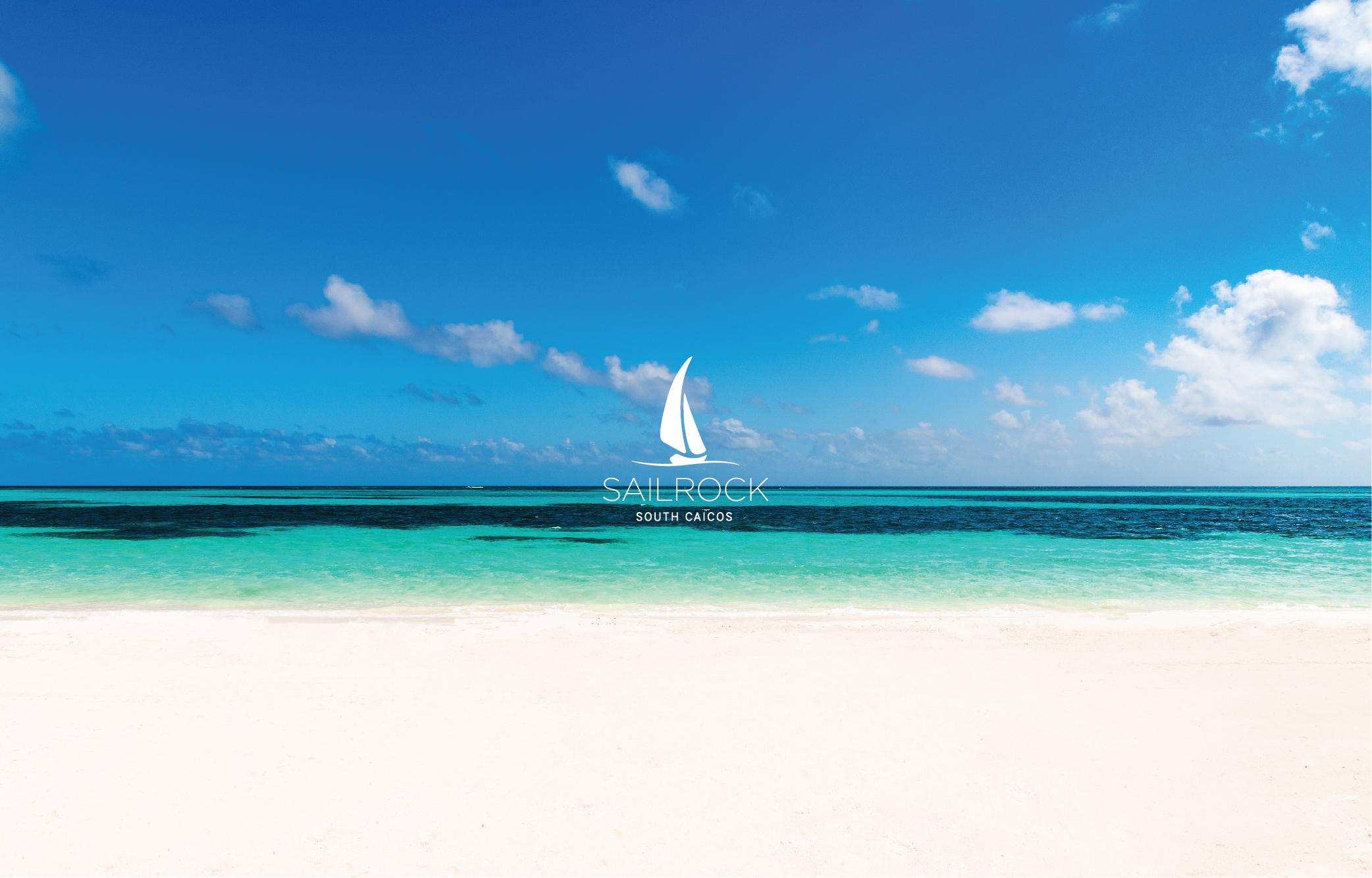 Sailrock South Caicos logo set over an image of an ocean beach