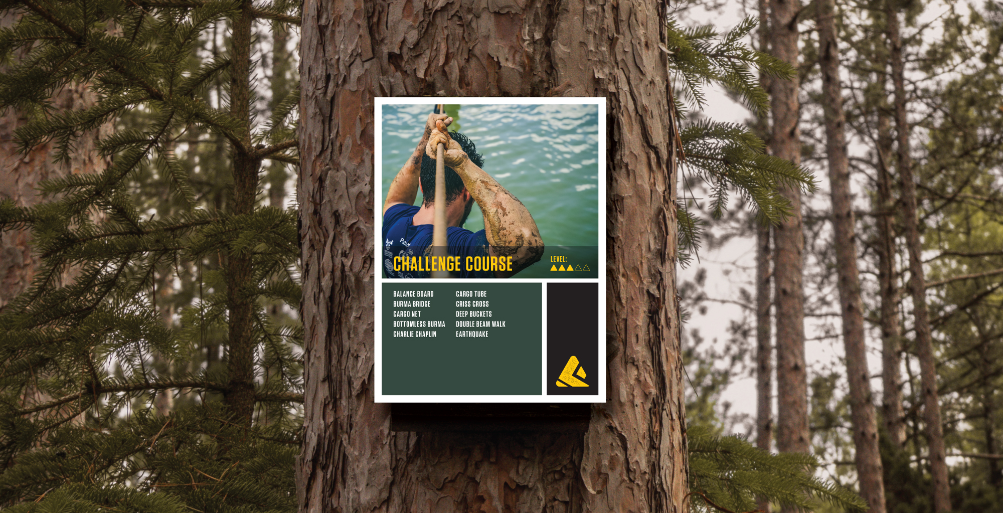 The Forge challenge course signage affixed to a tree trunk
