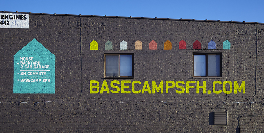 BasecampSFH.com painted across the side of a brick below, with paint swatches including coral pink
