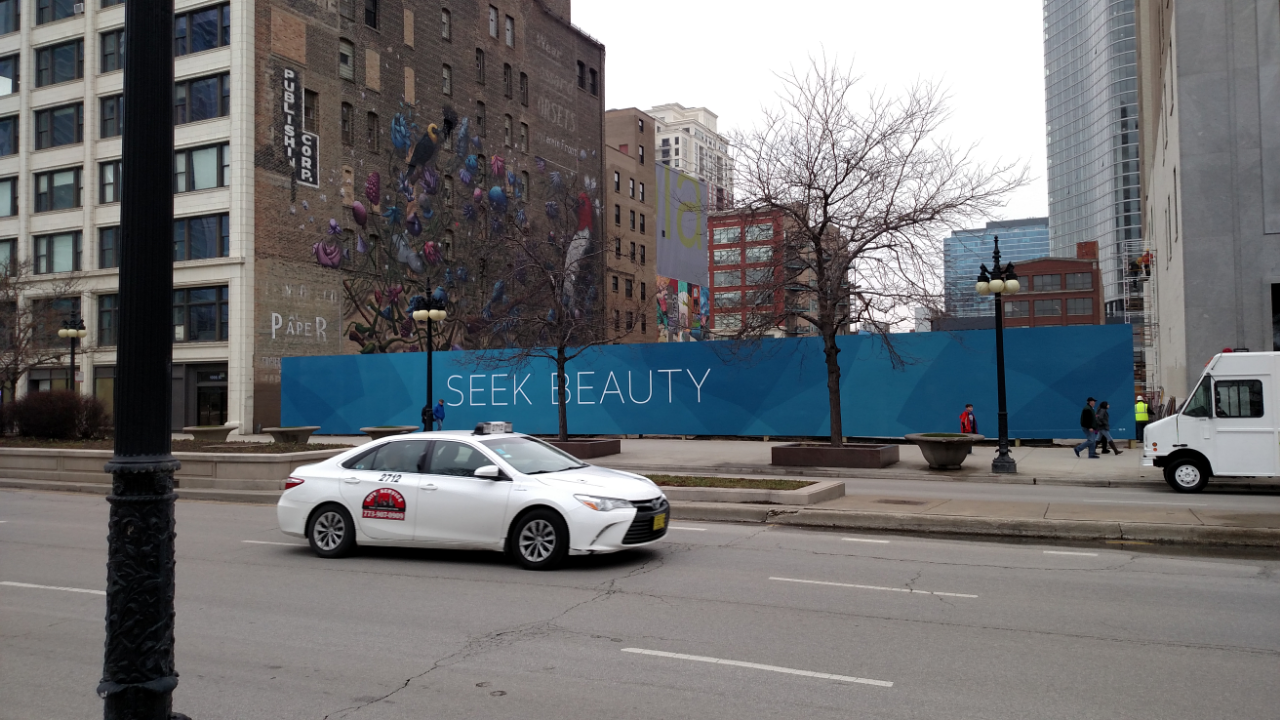 The 1000M construction barricade with Seek Beauty tagline on it