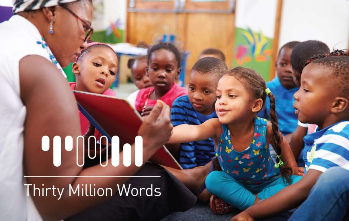 Logo design for Thirty Million Words visual identity, set over photo of learning children
