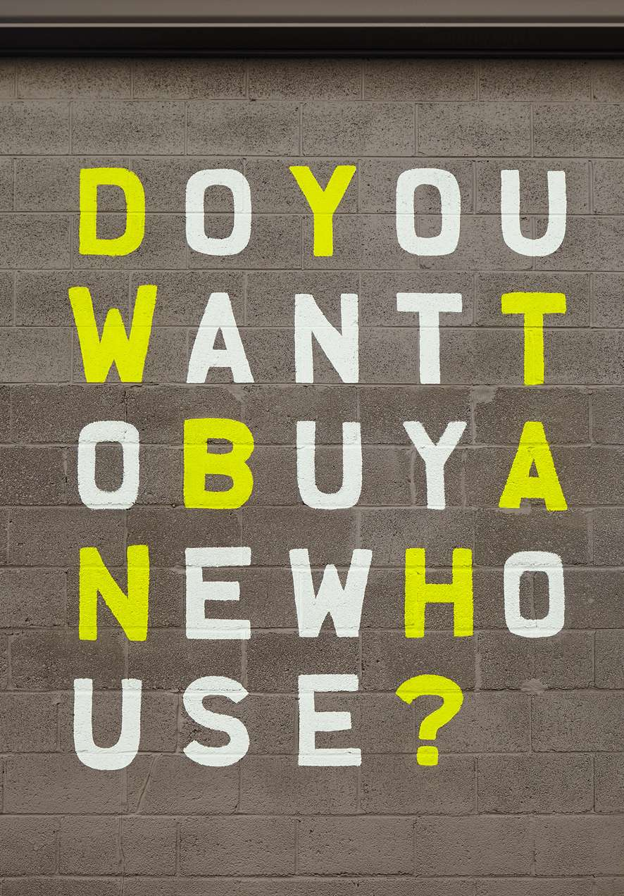 Outdoor advertising for Chicago real estate brand Basecamp, reading: Do you want to buy a new house?