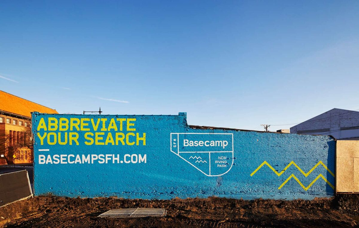 Abbreviate your search creative campaign on the side of a building for real estate brand Basecamp SFH