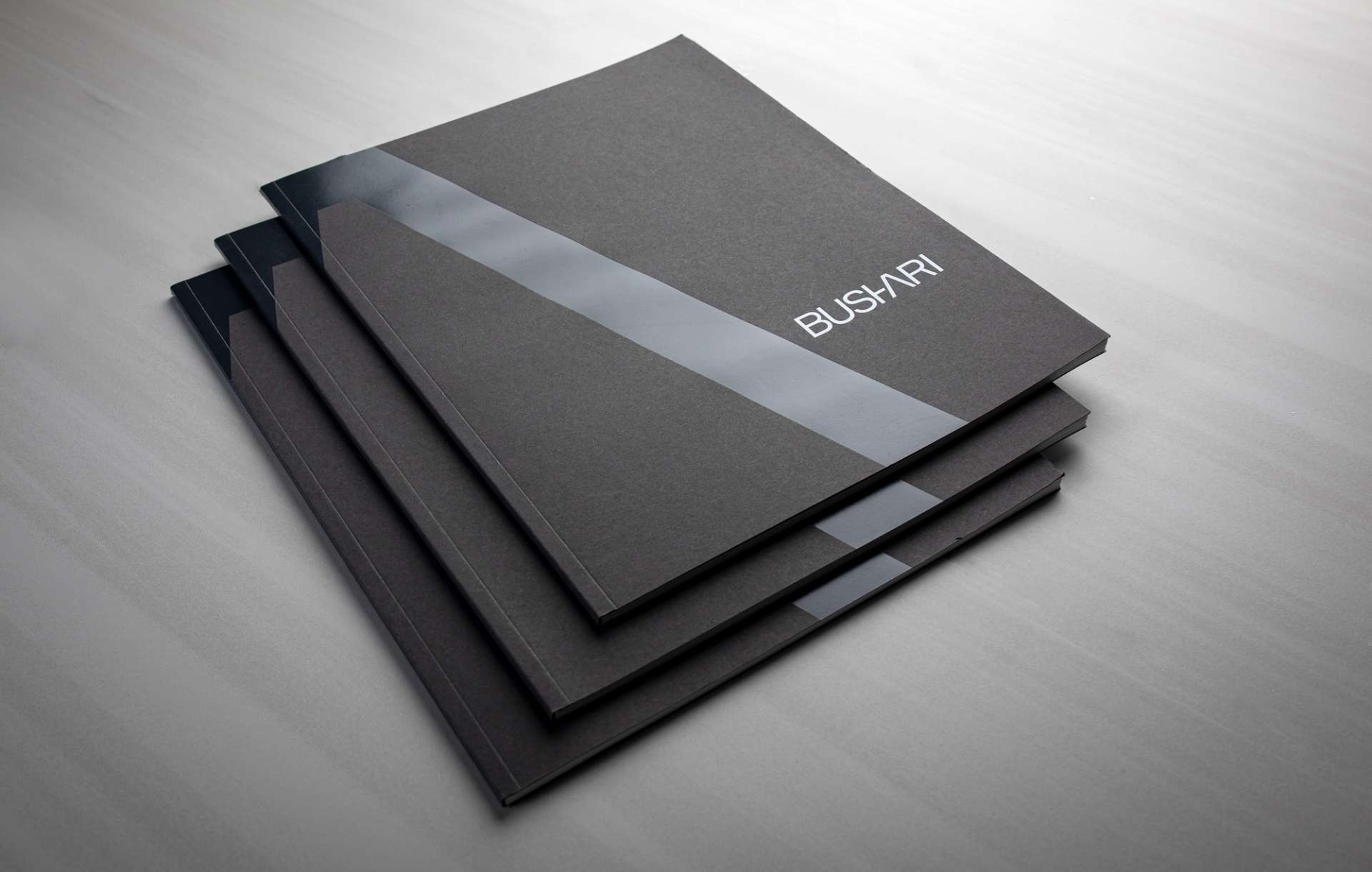 Print collateral kit design for Bushari real estate branding