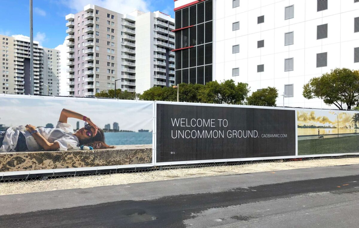 Outdoor advertising barricade during construction at Caoba site