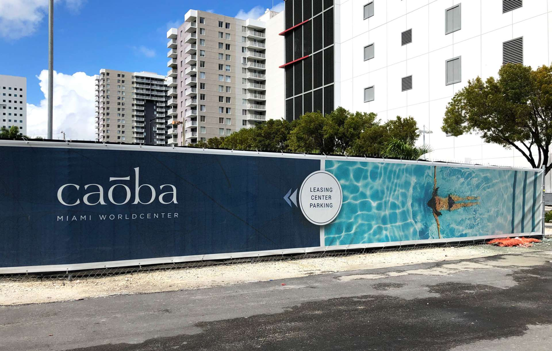 Outdoor advertising barricade for Caoba during construction