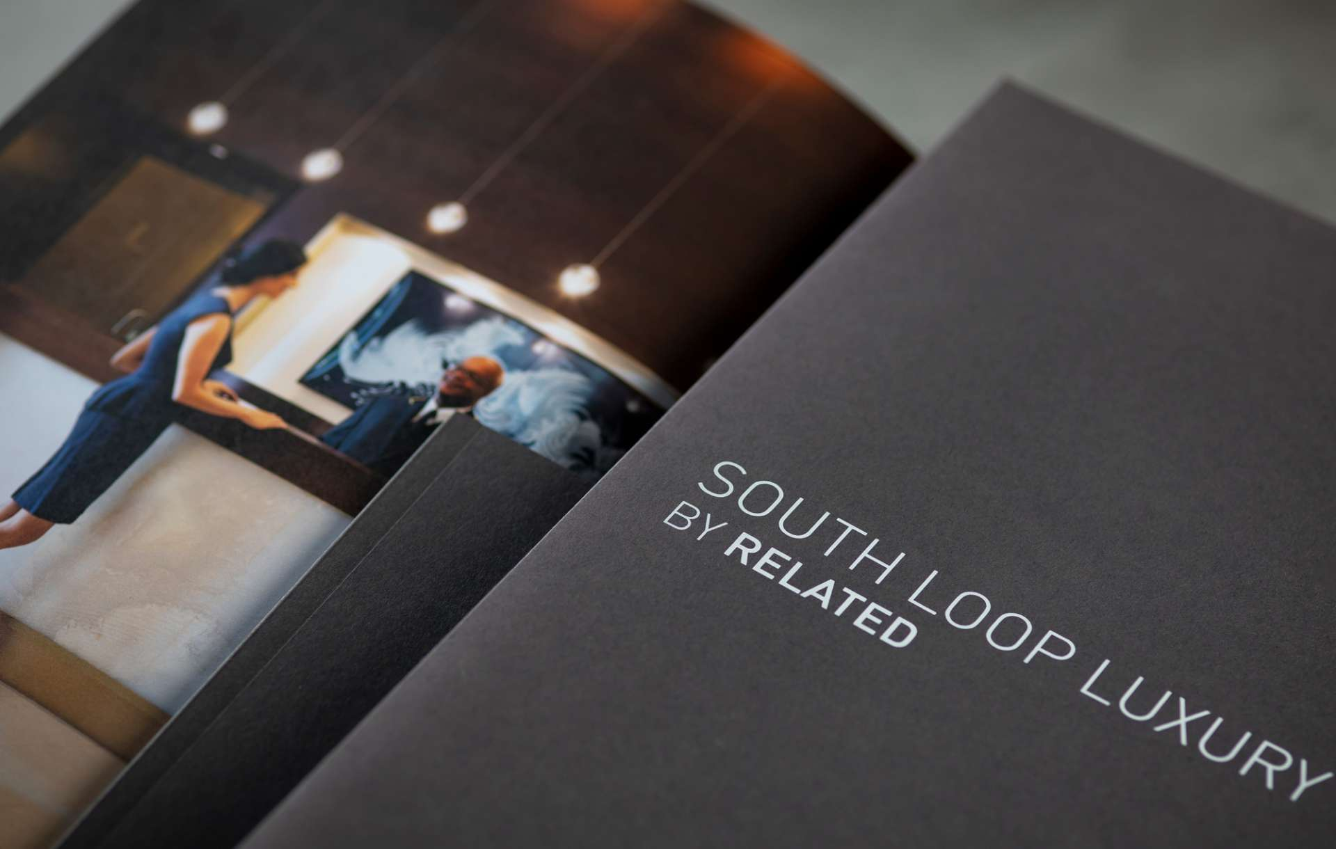 Real estate branding print collateral kit designed for South Loop Luxury by Related