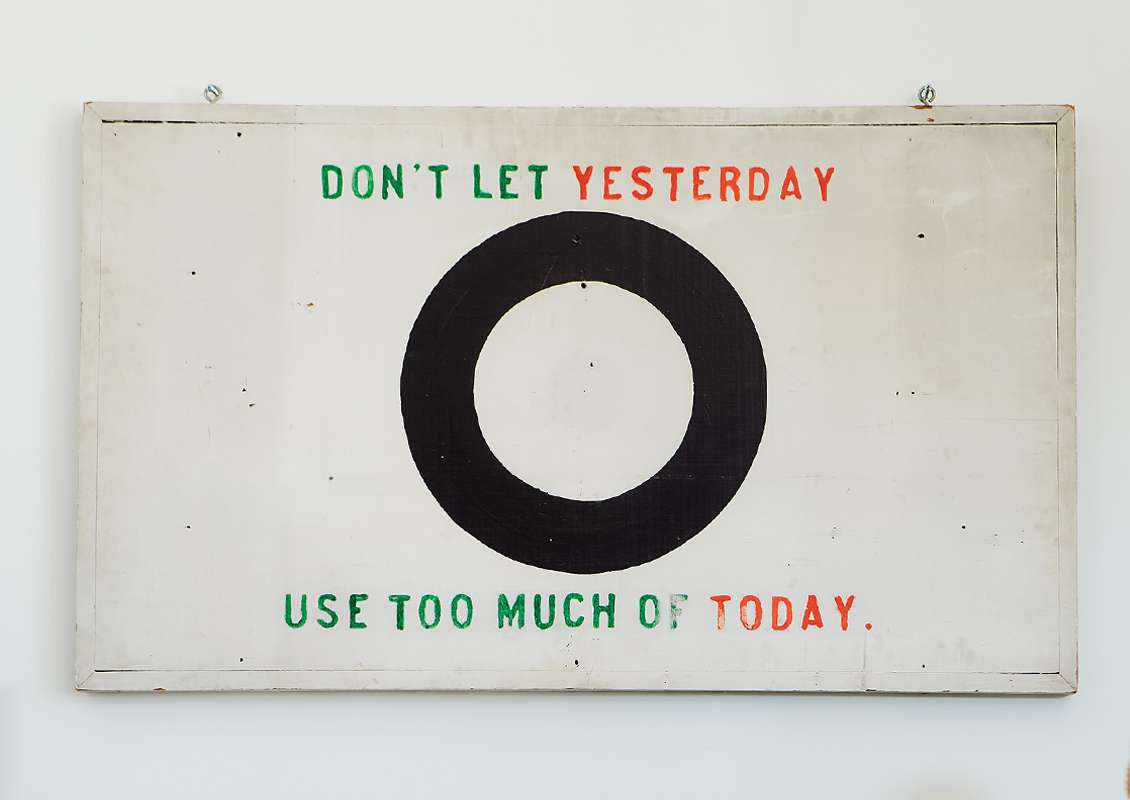 A graphic sign reads: Don't let yesterday use too much of today