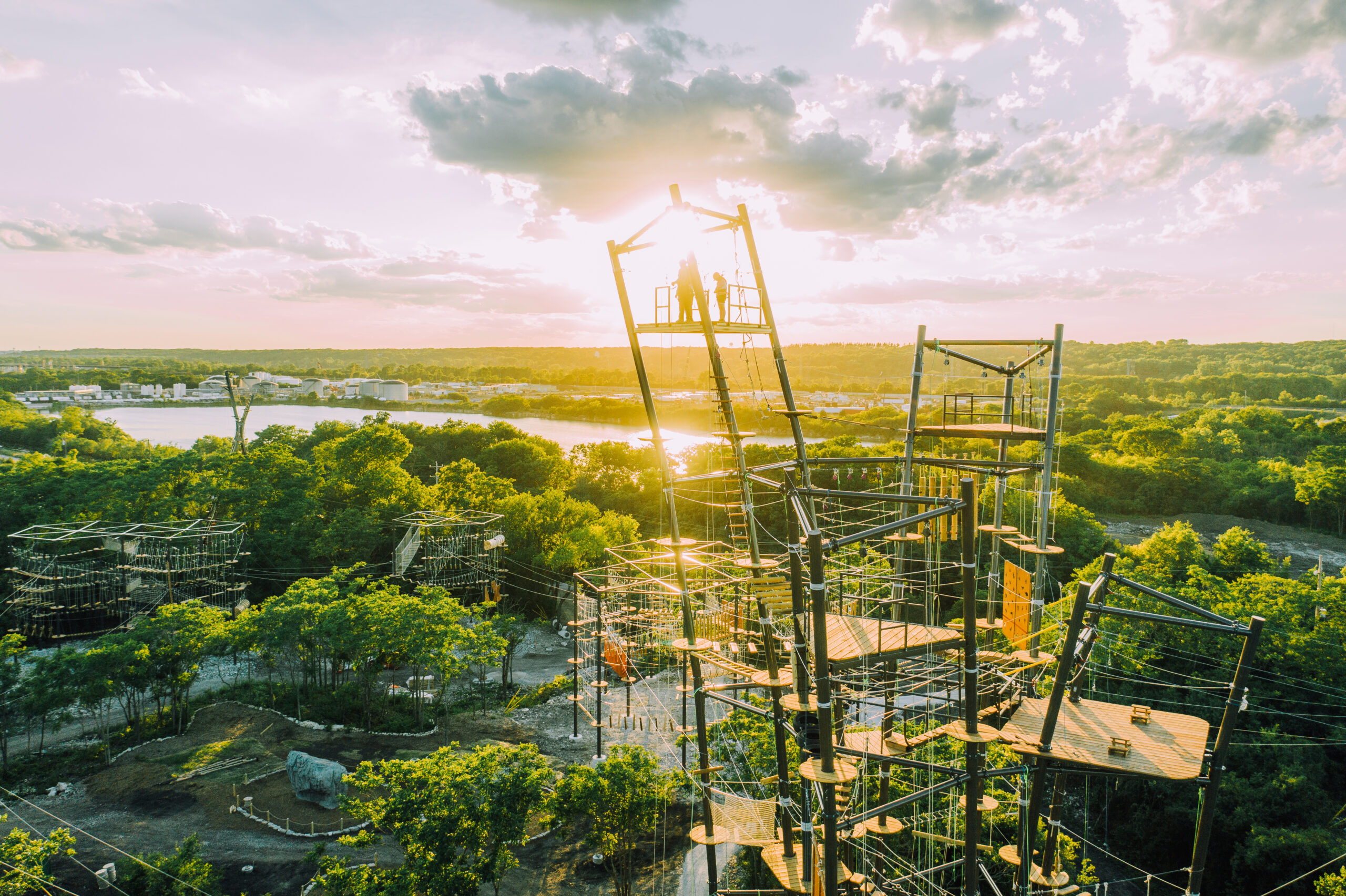 The eight climbing towers at The Forge: Lemont Quarries, seen from a high vantage point with the sun setting behind them
